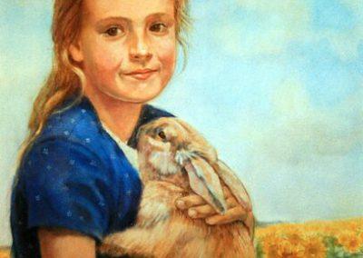 Een portret van een kind met een konijn